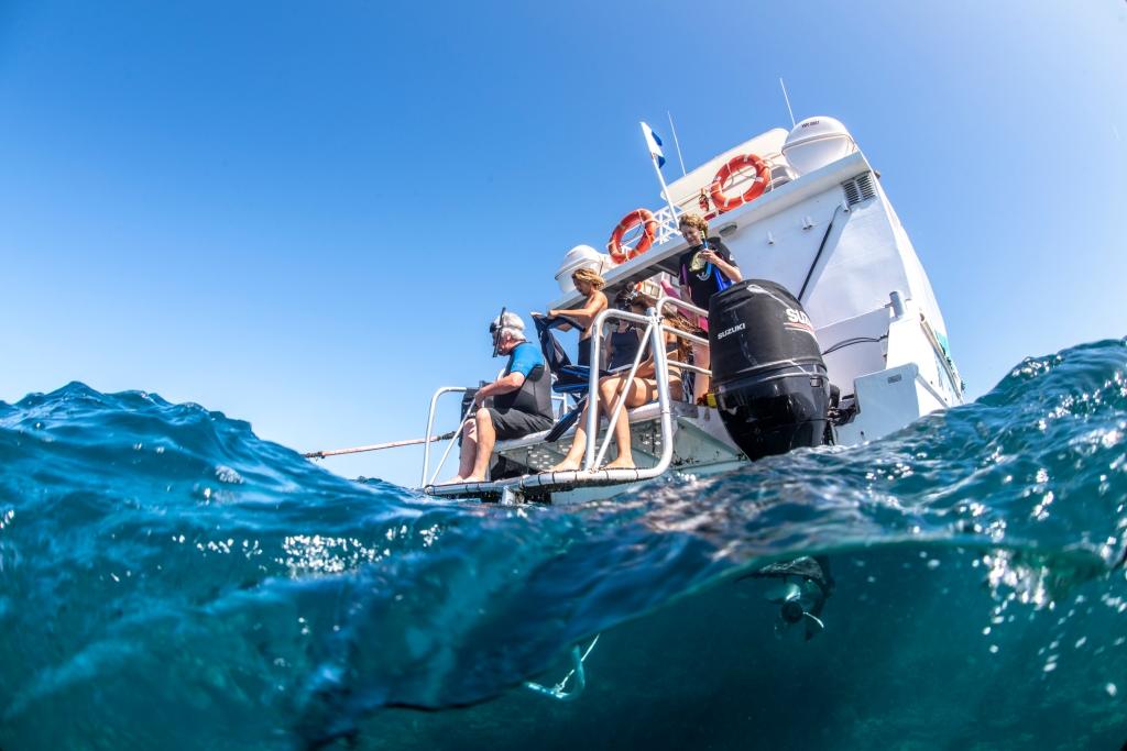 Boat jumping coral bay Ningaloo reef